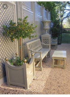 A monochromatic French-style outdoor area makes the greenery pop.