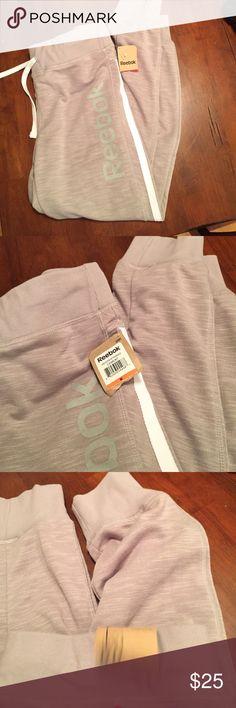 Reebok cuffed sweat pants. Never worn. Reebok cuffed sweat pants. Never worn. Reebok Pants Track Pants & Joggers