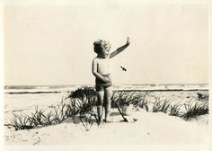 """""""This tiny miss finds the beach at Port Aransas just right to play with pail and shovel,"""" read the cut line of this photo when it was featured in 1931. Photo: San Antonio Express-News"""