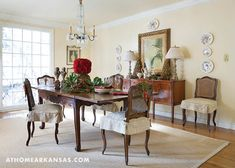 """Antique furnishings and fixtures fill the home's dining room. The wall color is Pratt & Lambert's """"Chamois"""" and can be seen throughout the home. The kitchen underwent the biggest renovation with a new, more workable floor plan that includes a large island for gathering. 