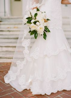 Thank you Chip & Jo Gains for making magnolia leaves so popular this year! This southern wedding bouquet is STUNNING with its peony blossoms and sweet magnolia accents. The whole wedding is greenery glam.