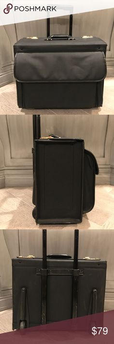 Business roller carry-on Keep all your business essentials organized perfectly. Heavy duty black canvas. Leather handle. Gold tone combo locks. Telescoping rear pull handle. Light normal bumps and scuffs from travel. Handsome and practical. Bags Luggage & Travel Bags
