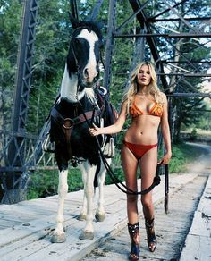 It had me at the horse and then this is like a woman really dudes u don't go riding with a swimsuit. Retards