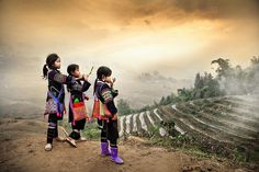 """""""Three village girls from a hill tribe in Sapa, north Vietnam, look out over their world of mountains and rice terraces.  This photo was taken while I was a trekking through the region, and from time to time I would come across colourful, local village people who lived in the surrounding villages in the hills."""""""