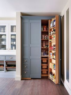 This traditional kitchen features a gorgeous built-in pantry with gray doors and a wooden interior with plenty of shelves and drawers for multipurpose storage Kitchen Pantry Design, Kitchen Pantry Cabinets, Diy Kitchen Storage, Kitchen Organization, New Kitchen, Organization Ideas, Kitchen Decor, Base Cabinets, Smart Kitchen