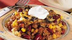 Taco casserole goes slow and sirloin!  Traditional toppings included.