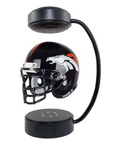 The NFL Hover Helmet boasts an innovative half-scale replica helmet design that showcases artwork of your favorite NFL team. Electromagnetic base allows helmet to hover and rotate indefinitely while built-in LED lights provide gentle illumination. Nfl Seattle, Nfl Chicago Bears, Seattle Seahawks, Nfl Denver Broncos, Broncos Fans, Pittsburgh Steelers, Seahawks Football, All Nfl Teams, Nfl Baltimore Ravens