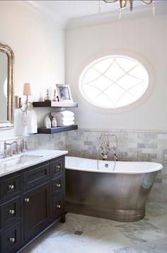 I love the earthy grey themes, however the bath deserves more space!