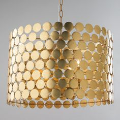 """Dotted Metal Drum Shade Chandelier Connect the dots to find this stylish mod chandelier ready to grace your home. The gold leaf finish explodes on the scene. The gold dot design is simple yet glamorous and will elevate any interior by the glowing warmth of its silhouette.  3x60 watt candle base lamps max.  (15.75""""Hx24""""W)"""