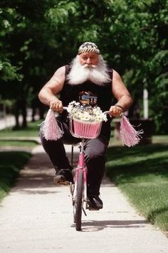 Made me laugh....Santa on a girls bike. I always wondered what he did with his summers.