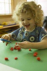 Cutting playdough - intro to scissors