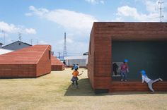 Mukou Leimondo Nursery School by Archivision Hirotani Studio. A playground covering the roof of this kindergarten in Kyoto Prefecture, Japan, is dotted with wooden obstacles that function as light wells for the nurseries underneath.