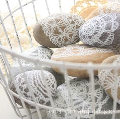 Easter Centerpiece Idea * Lace Rock Eggs * Fill a basket with painted lace rock eggs, sponge paint over paper doilies to achieve the look. * from erin's art and gardens