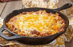Cheesy Beef Casserole - Spicy beef casserole with cabbage, tomatoes, and gooey melted cheese.