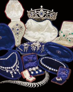The Royal Order of Sartorial Splendor! Ruby ring auctioned at Christies for $3.2m, tiara $1.5m, pearl brooch for $2.3m.