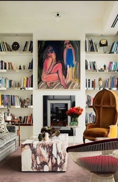 David Hicks, styled bookcases, art over fireplace, eclectic mix, modern chair