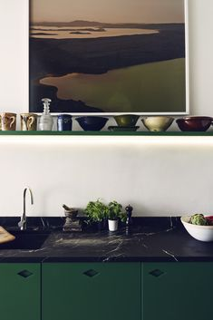 Black marble counter - I think i *really* love this counter (not the green cabinets)