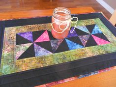 Country Colors Quilted Table Runner/ Scrap Quilt Pinwheel Pattern Batik Fabrics in Black, Blue, Pink and Green by RubysQuiltShop on Etsy