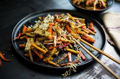 I've made many rainbow pepper stir-fries, but this time I used my multicolored carrots, and cut them into matchsticks so they would cook quickly along with the spring onions. I wanted this to be a main dish, so I added tofu, as well as the aromatics that I always use in my stir-fries: garlic, ginger, dry sherry, soy sauce and a bit of sugar. (Photo: Andrew Scrivani for The New York Times)