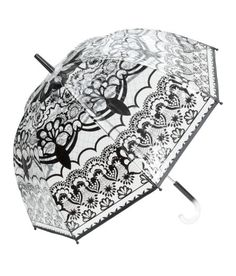 Check this out! Umbrella in transparent patterned plastic with a plastic handle. Length 30 1/4 in. - Visit hm.com to see more.