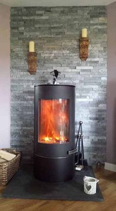 Our Silver Grey - Large Split Face Mosaic Tiles have made a stunning feature of Lorraine Miller-Parr's wood burning stove.