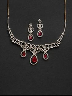 Extraordinarily  entralling combination of diamonds and rubies set in 14carat gold, wear this angelic necklace and let the heads turn.
