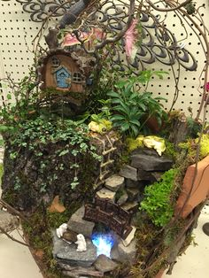 Broken pot with fairy babies and water feature in a woodland setting. Design by Kristin Middleton