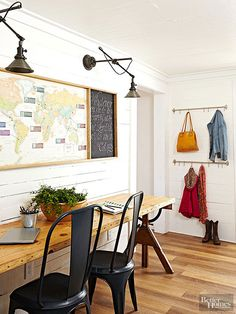 Such a cool desk area - wood slab desk with vintage legs, swing arm sconces, vintage map