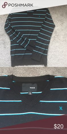 Black Hurley sweater w/ White & Blue stripes Black Hurley sweater w/ White & Blue stripes.  Size large, cotton and fitted look. Hurley Sweaters Crewneck
