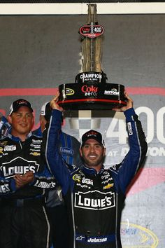 Jimmie Johnson, driver of the #48 Lowe's Dover White Chevrolet, celebrates with the trophy in victory lane after winning the NASCAR Sprint Cup Series Coke Zero 400 at Daytona International Speedway on July 6, 2013 in Daytona Beach, Florida.