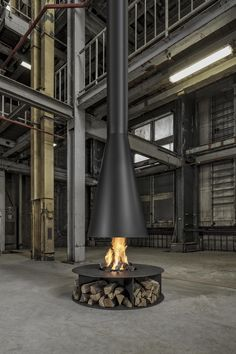 Introducing the Conical fireplace - can be gas or wood, and looks simply stunning.