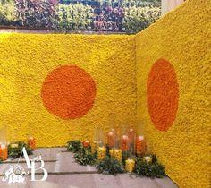 An enchanting floral wall bunched with the eye-pleasing combination yellow and orange marigolds. Wedding Hall Decorations, Diy Wedding Backdrop, Floral Backdrop, Flower Decorations, Indian Wedding Theme, Indian Wedding Photos, Wedding Photo Checklist, Mehndi Decor, Mehendi