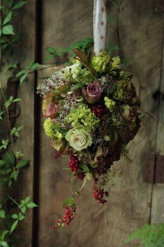 .start with a grapevine ball, fills with moss and then add succulents and flowers
