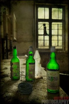Green bottles in an the kitchen of an abandoned house