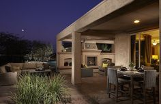 Contemporary Porch with outdoor pizza oven, Fence, Wrap around porch, exterior tile floors
