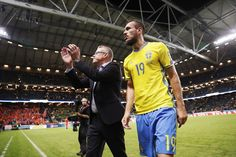 Janne Andersson, head coach of Sweden and Emir Kujovic of Sweden after the FIFA World Cup Qualifier between Sweden and Netherlands at Friends arena on September 6, 2016 in Solna, Sweden.