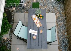 7 Ideas to Steal from Real People's Tiny Backyards - like the grey river rocks mixed with brown pebbles