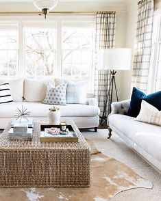 "One thing I really love about what we do is that we get to take our client's style and then put our spin on it. This ""fresh traditional"" room makes me so happy. You know what else is happy? That navy velvet pillow is 20% off (with the rest of our SM pillows) through the weekend!  {lamp, coffee table, cowhide, and accessories are also in the shop} #countryclubtraditional"