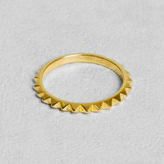Petit Sesame | Gold-plated pyra ring | Designed by Petit sesame | $11.00 | 18k gold plated full brass ring adorned with pyramid studs