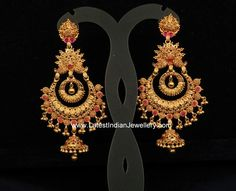 Heavy designer antique gold chand bali earrings dangle in beautiful and elaborate design studded with few rubies. The gorgeous gold earrings are perfect Chand Bali Earrings Gold, Gold Jhumka Earrings, Jewelry Design Earrings, Gold Earrings Designs, Gold Jewellery Design, Gold Jewelry, Jewelery, Necklace Designs, Wedding Jewelry