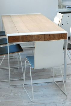 Solid oak and steel dining table. Legs powder coated white.
