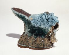 Chopines, circa 1590-1610, Italy.  The chopine was a tall clog worn primarily in Venice from the 15th to the early 17th centuries. While most examples are between three and five inches tall, some specimens of over a foot tall survive. Historical accounts testify to the necessity of the assistance of a pair of ladies maids to walk in the more extreme examples.