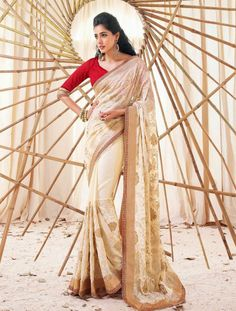 Cream Saree With Red Blouse Makes An Attention Gaining Impression, And Yes This Saree Offers You The Same At Just Rs. 4,572. Shop Now At http://goo.gl/0bDjKY