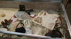 """3 Dec 2015 Theme: """"Christmas Memories"""" This case contains a wonderful collection of items from the late 1800s to the early 1900s. On loan from Gail Meloy."""