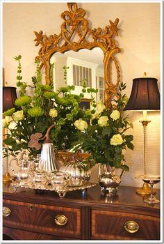 Vignettes...Mirror.. sideboard..floral arrangement.. silver accessories...