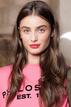 """A beauty look based on the duality of being grown up yet youthful and fresh. """"The trick to the perfect, non-gloopy red lip is to use a lipstick with a clear gloss on top, then you can add just the right amount of gloss,"""" says YSL Beauty Director Tom Pecheux."""