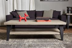 The Avalon coffee table features an acacia top and shelf, supported by black metal legs. Built with high-grade materials, this stunning series will be a lasting favorite. Coffee Table Grey, Metal Furniture, Accent Pieces, Black Metal, Bookshelves, Dining Bench, It Is Finished, Sofa, Acacia
