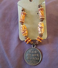 Handmade suede necklace with beaded accents and pendant by AmyMaesTruePassion on Etsy