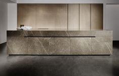 Grafite brown limestone and sandblasted oak kitchen.
