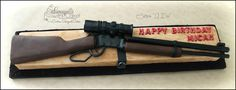 "Henry Lever Rifle - This cake was a labor of love, that's for sure. It seemed like it took days to make this rifle. Gun is made out of rice cereal treats, cake, fondant and gumpaste and is 100% edible. Wooden box is made out of cake and covered in fondant, then brushed with cocoa powder to give it that wood look. This was the 3rd cake that I got to do with my friend and fellow cake designer, Deanne, from Cakes ""I Do!"". It was great having her here with me for the week. TFL"